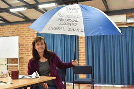 Denyse-McNish-with-protest-umbrella-photo-D-Mc-Dougie-2017